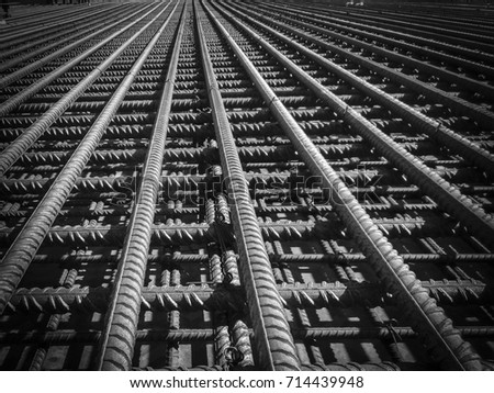 Steel Rebars for reinforced concrete. Closeup of Steel rebars. Geometric alignment of Rebars on construction site