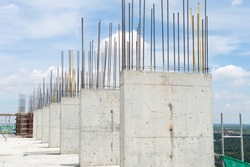 Steel reinforce in concrete column.Steel grid on the construction site.Reinforcement of concrete work. Using steel wire for securing steel bars with wire rod for reinforcement of concrete