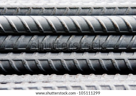Steel rods or bars used to reinforce concrete, background