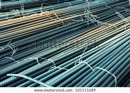 Steel rods or bars used to reinforce concrete, in warehouse