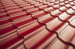 Steel roof painted in red color. Red roof.