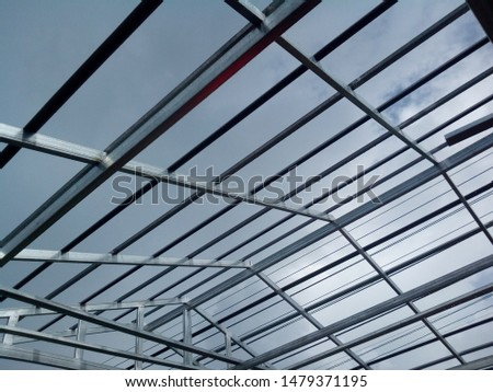 Steel roof structures that are under construction #1479371195