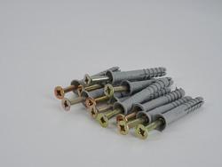 steel screws, metal screw, iron screw, screws as a background, wood screw. Iron or metal screw nails stack industrial building industry background.