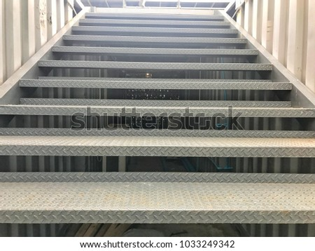 Steel staircase ascent upstairs, staircase barrier wall  to background sky landscape, iron staircase up 2nd floor, front staircase