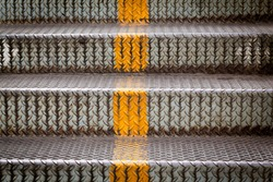 steel stairs with yellow line for separated up or down