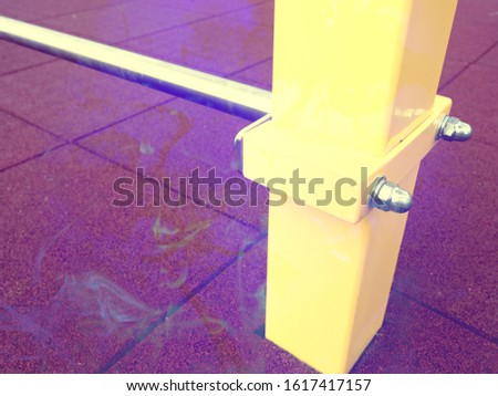 Steel stick or stake sticking out from  the tile ground with pink rubber.  Abstract filter.
