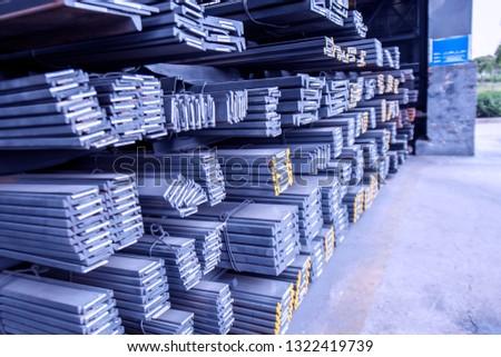 Steel stockpiled in steel warehouse
