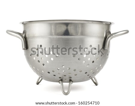 Steel strainer sieve metal bowl isolated over white background - stock photo