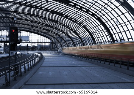 Steel structure main hall of Berlin central station (Hauptbahnhof), with a fast moving train at high speed, in a cyanotype composition