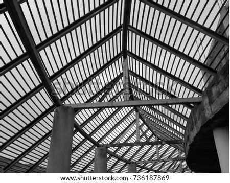 Steel structure of a building black and white background.