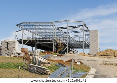 Steel structure of a new commercial building and workplace area around