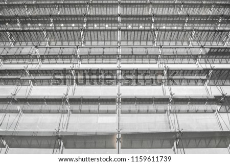 Steel structure roof of office building. Windows glass facade supported. Abstract architecture fragment background. #1159611739