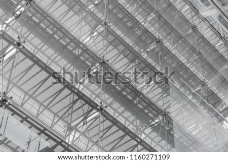 Steel structure roof of office building. Windows glass facade supported. Abstract architecture fragment background. #1160271109