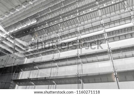 Steel structure roof of office building. Windows glass facade supported. Abstract architecture fragment background. #1160271118