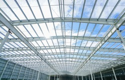 Steel structure roof truss under the construction building in the factory with blue sky