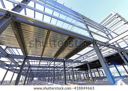 Steel structure workshop is under construction  #418849663