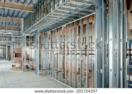 Steel studs used to frame in a large commercial building.