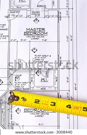 Steel Tape Measure on House Blueprints