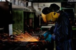 Steel Welding Spark Worker Industry Assembly craftsman is welding with workpiece steel. Working person About welder steel Using electric welding and safety equipment in factory industry.