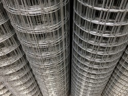 steel wire mesh material for the construction of reinforced concrete structures. close-up, model industrial background.