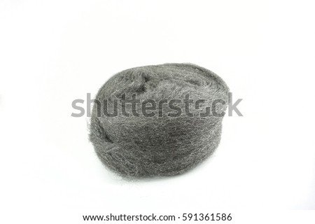 Steel wool on white background. Selective focus with shallow depth of field
