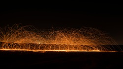 Steel wool photography at the desert rat night time with fire splash all over. Slow Shutter speed photography with steel wool