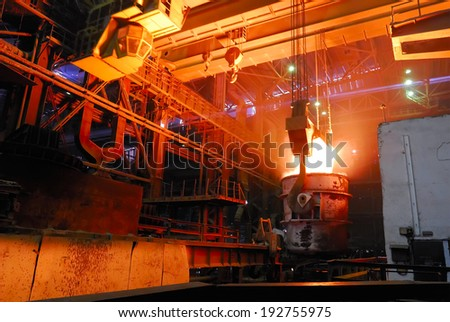 steel works crane with stove busket