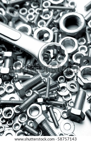 Steel wrench on nuts and bolts
