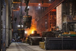 Steelmaker at ingot casting. Electric arc furnace shop EAF. Metallurgy.