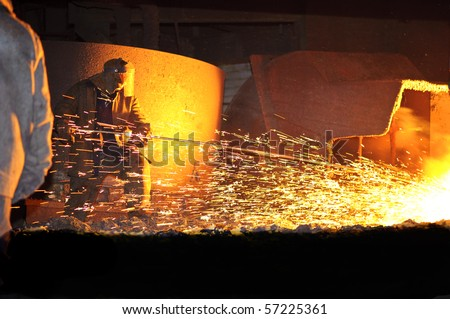steelmaker burns oxygen opening for producing of cast-iron from a high furnace