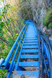 Steep blue stairs along the cliff