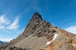 Steep eroded rough mountain peak