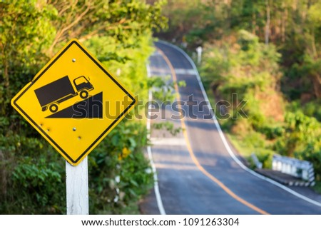 Stock Photo Steep grade traffic sign on the roadside, uphill asphalt road in countryside