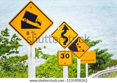 Steep Hill Descent Use Low Gear Traffic Sign on the Road in Thailand