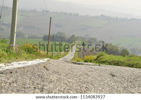 steep road leading to villages in the mountainside of italy #1134083927