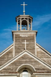 Steeple, bell tower and crosses of St. Joseph Catholic Church in Courval, Saskatchewan