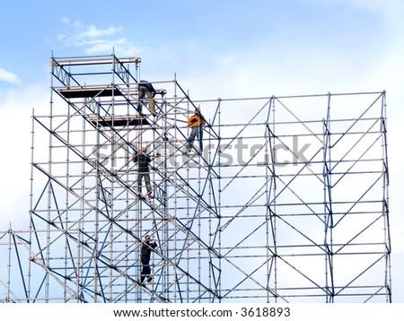 Steeplejacks on a scaffold in the sky - stock photo