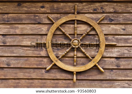 steering weel on wooden background
