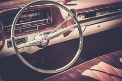 Steering wheel and dashboard  of a classic 1960s American Automobile