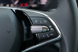 Steering wheel buttons of a modern car, adaptive cruise control functions
