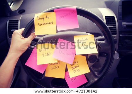 Steering wheel covered in notes as a reminder of errands to do #492108142