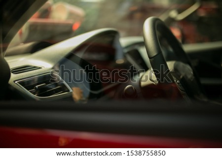 steering wheel of a red sports car. view of the interior of a red sports car. Luxury sports car Interior. Red style. #1538755850