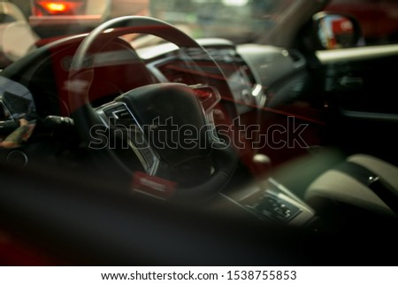 steering wheel of a red sports car. view of the interior of a red sports car. Luxury sports car Interior. Red style. #1538755853