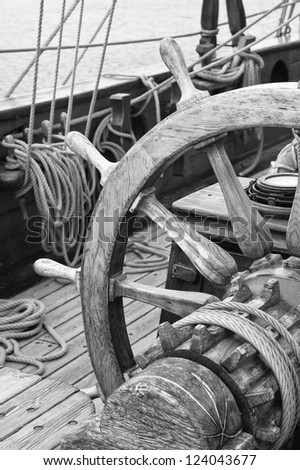 Steering wheel of an ancient sailing vessel, black and white photo
