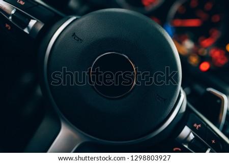 Steering wheel of modern car. Vehicle or car interior.  #1298803927