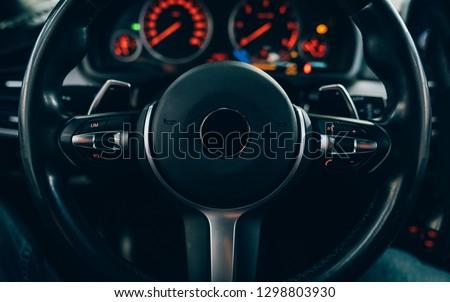 Steering wheel of modern car. Vehicle or car interior.  #1298803930