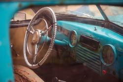 Steering wheel of old abandoned car