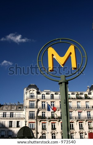 steet picture with a M (metro) sign in the Montparnasse area