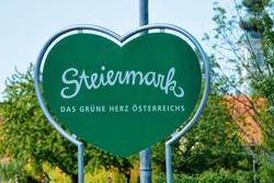 Steiermark, or Styria in Austria. Modern green Traffic warning road sign - heart shape safety construction symbol. Design element. Street blank information concept. Retro Highway. Transportation board