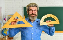 Stem education concept. study algebra at university. back to school. teacher of arithmetic. calculation and search of various data. precision measurement tool. man use protractor and triangle.